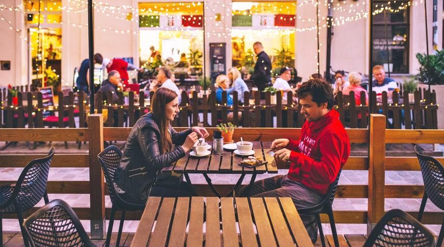 Young couple dining on ul. Św. Antoniego, Wrocław Poland.