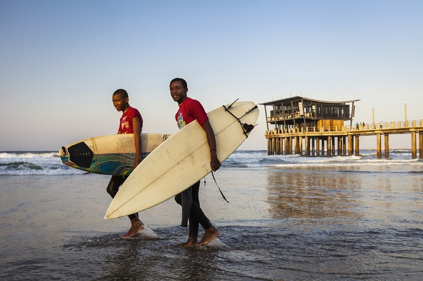 Surfers on the beach in Durban