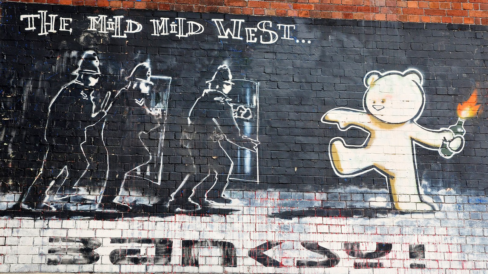 Guide to Finding Banksy in Bristol - Mild Mild West (Teddy bear v Police)