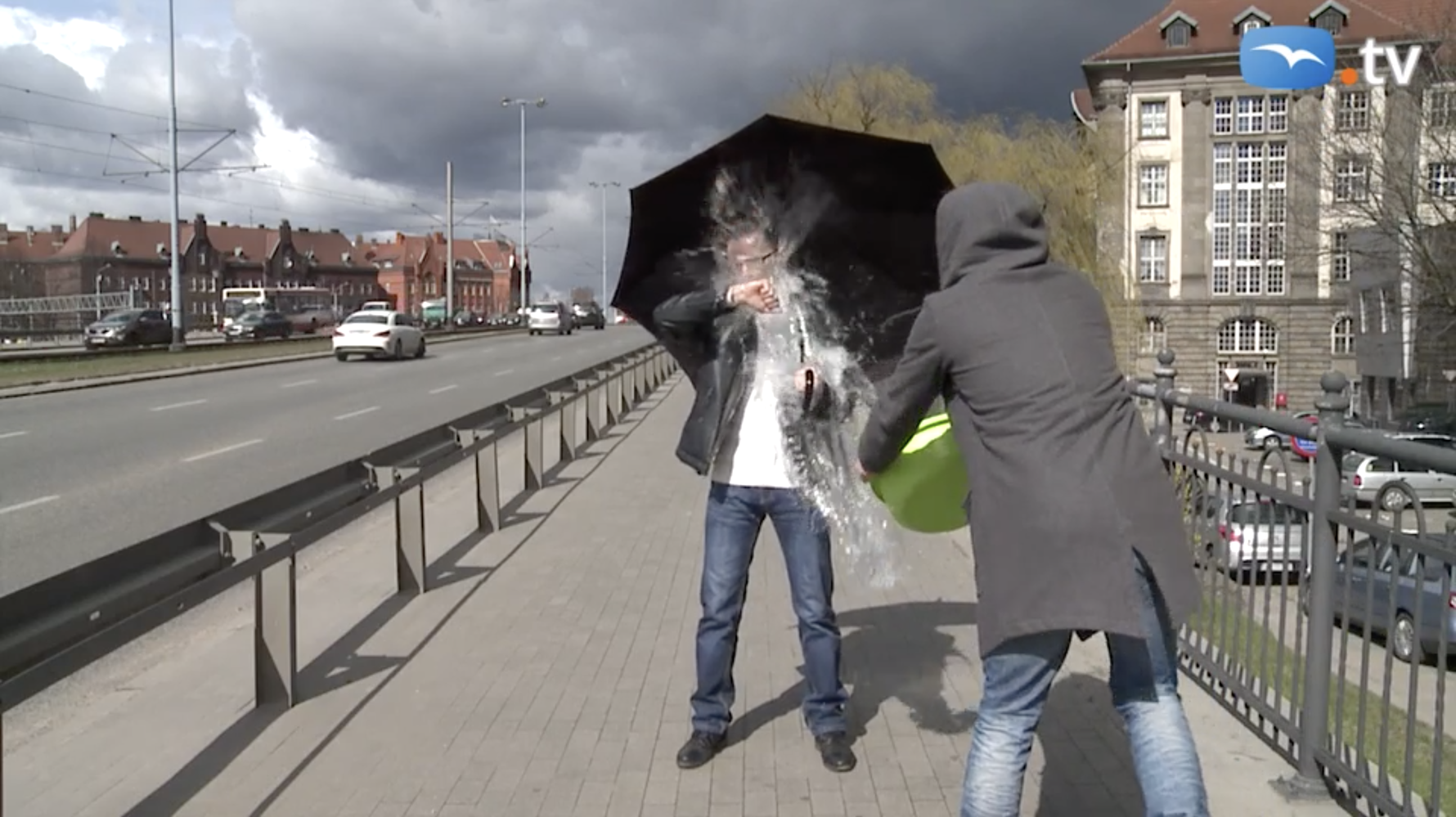 Trojmiasto TV Reporter Rafał Borowski being dunked with water in Gdańsk