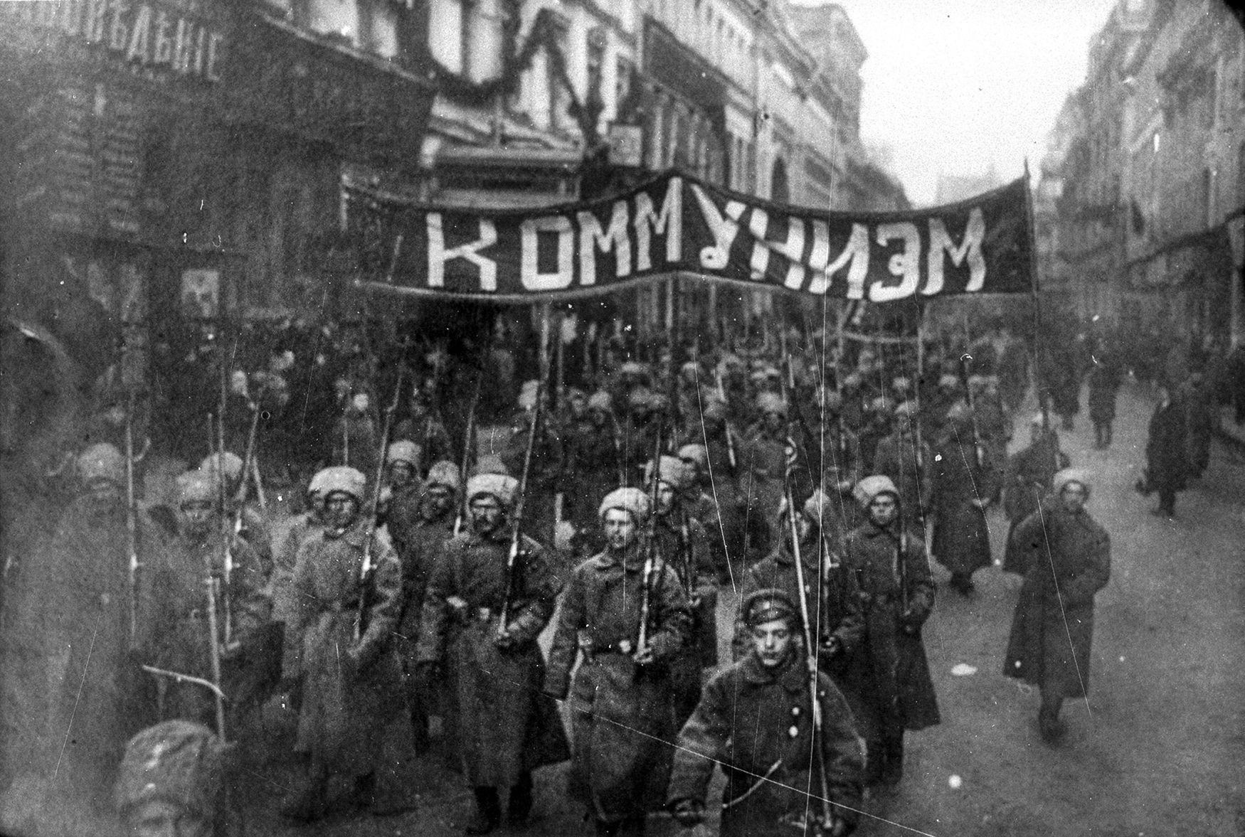 Russian Revolution Attractions in Moscow-Armed soldiers carry a banner reading 'Communism', Nikolskaya street, Moscow, October 1917