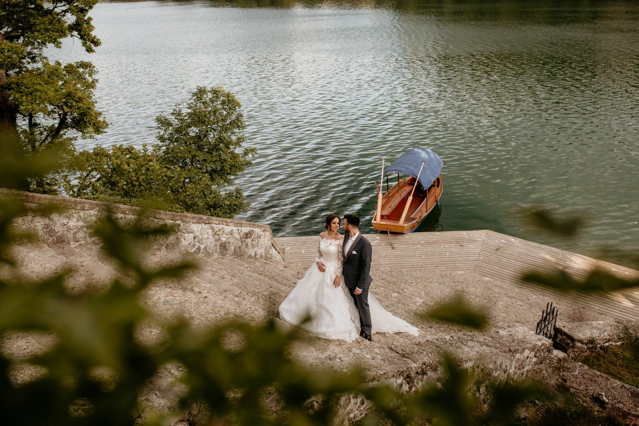 Bride and groom by Lake Bled