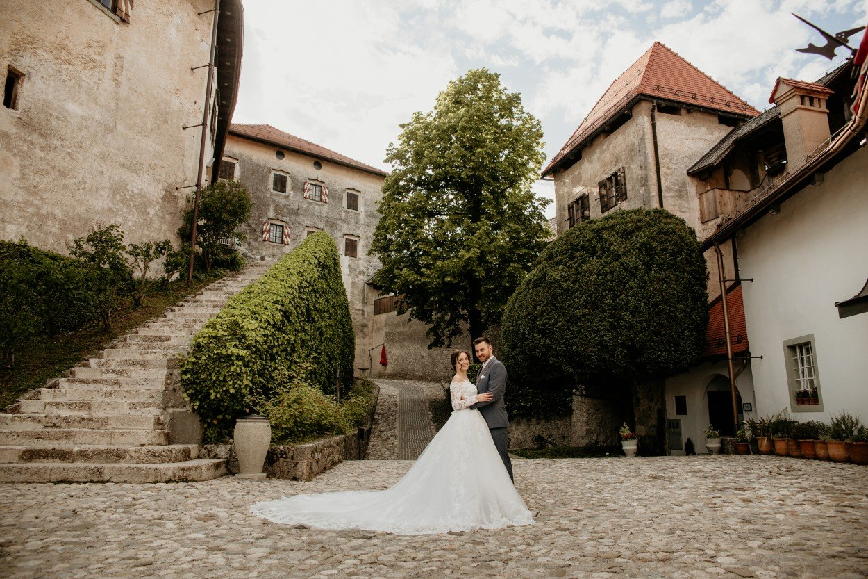 Bride and groom hugging at Castle bled