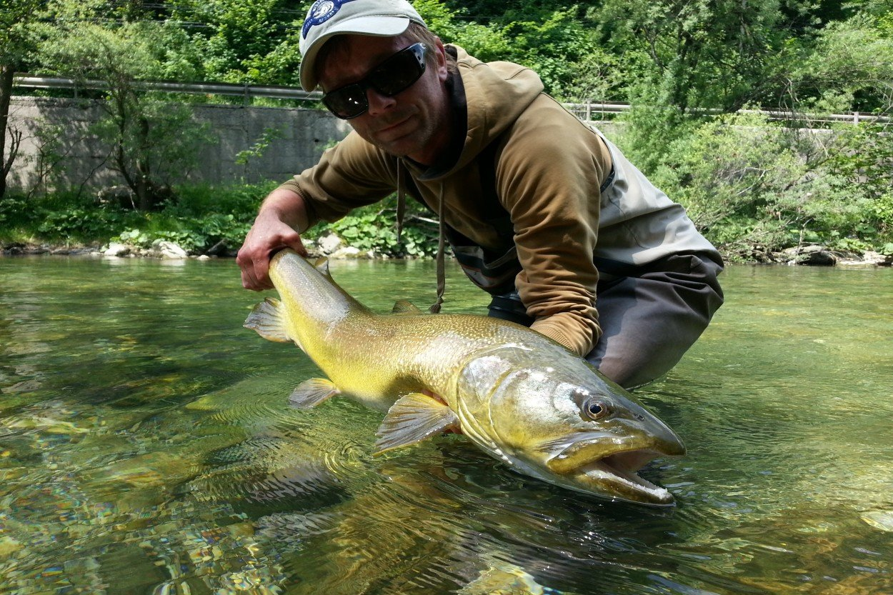 Fisherman with his catch / Slovenia Fishing Guides